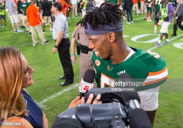 University of Miami Hurricanes Quarterback N'Kosi Perry smiles as he is interviewed by ESPN sideline reporter Allison Williams after the college...