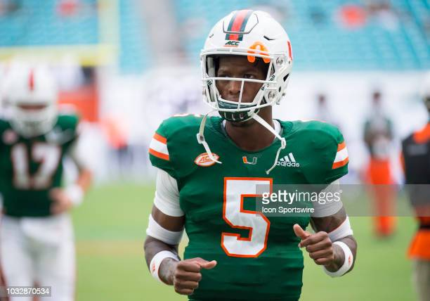 University of Miami Hurricanes Quarterback N'Kosi Perry warms up on the field before the start of the college football game between the Savannah...
