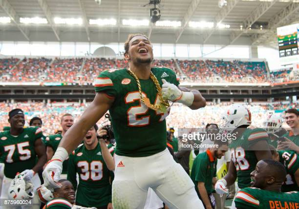 University of Miami Hurricanes Running Back Travis Homer celebrates on the sidelines with the UM Turnover Chain after recovering a fumble by Virginia...