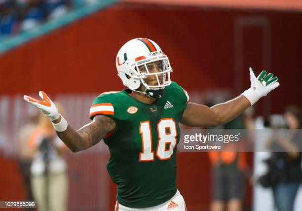University of Miami Hurricanes Wide Receiver Lawrence Cager gestures to the fans as he celebrates scoring a touchdown during the college football...