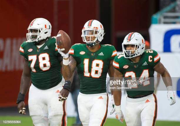 University of Miami Hurricanes Wide Receiver Lawrence Cager scores a touchdown along with University of Miami Hurricanes Offensive Lineman Tyree St....
