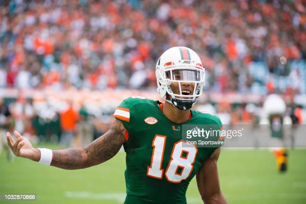 University of Miami Hurricanes Wide Receiver Lawrence Cager smiles and gestures on the field before the start of the college football game between...