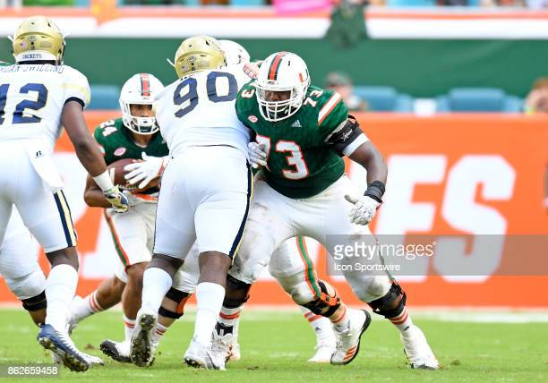 University of Miami offensive lineman Trevor Darling blocks Georgia Tech defensive lineman Brandon Adams during an NCAA football game between the...