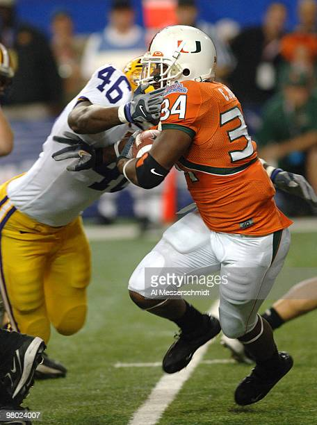 University of Miami running back Charlie Jones battles for a gain against LSU during the 2005 ChickfilA Peach Bowl at the Georgia Dome in Atlanta...
