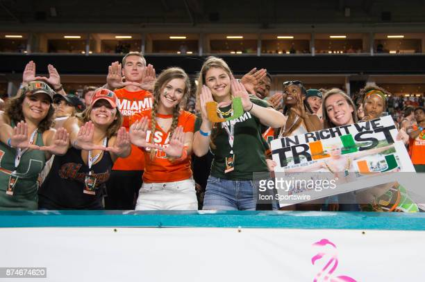 University of Miami students give the U sign and hold a sign stating 'In Richt We Trust' during the college football game between the Notre Dame...