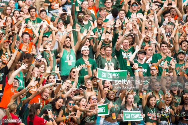 University of Miami students give the U sign during the college football game between the Savannah State Tigers and the University of Miami...