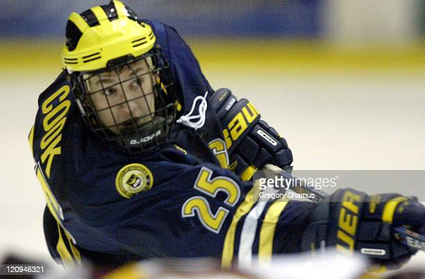 University of Michigan defenseman Tim Cook watches a slap shot head to the net against Ferris State during period action at Yost Ice Arena in Ann...