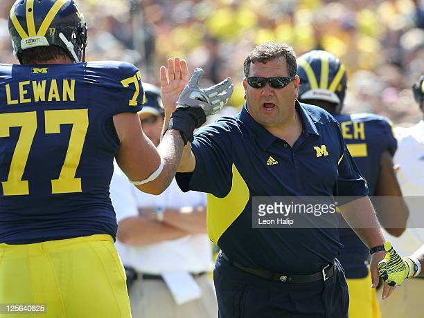 University of Michigan head coach Brady Hoke celebrates with Taylor Lewan during the game against Eastern Michigan University at Michigan Stadium on...