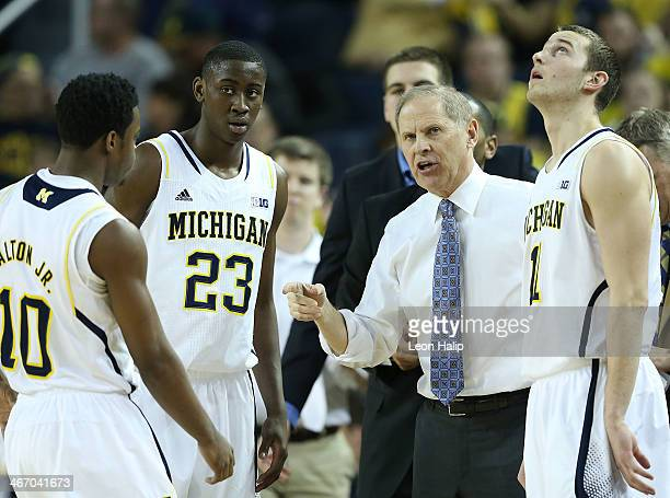 University of Michigan head coach John Beilein talks with Derrick Walton Jr Caris LeVert and Nik Stauskas during the first half of the game against...