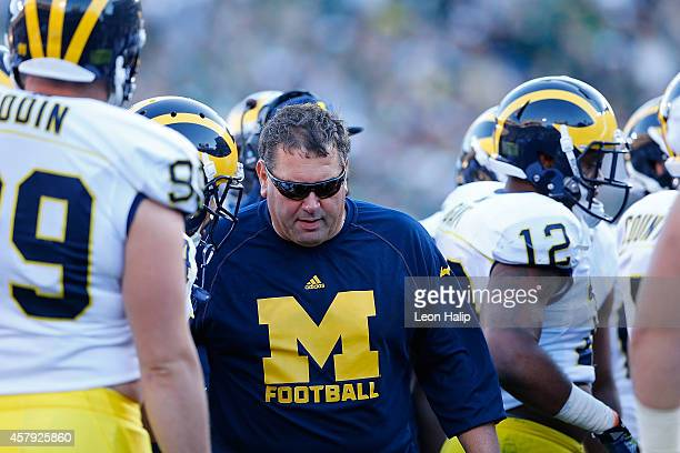 University of Michigan head football coach Brady Hoke watches the action from the sidelines during the second quarter of the game against the...