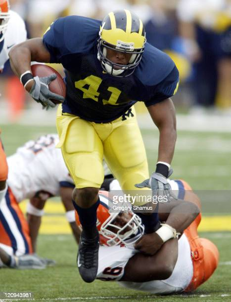 University of Michigan RB Tim Bracken breaks a tackle attempt by Illinois LB Antonio Mason during first quarter action at Michigan Stadium on October...