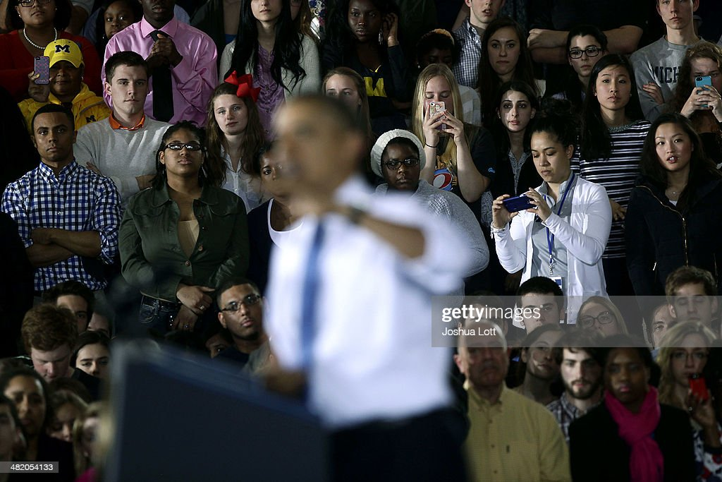 University of Michigan students listen as U.S. President Barack Obama speaks about his proposal to raise the federal minimum wage on April 2, 2014 in Ann Arbor, Michigan. Obama said every American deserves a fair working wage.