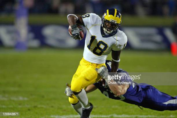 University of Michigan Wolverines' WR Antonio BassGrady is brought down by Adam Kadela after short gain during their game against the Northwestern...