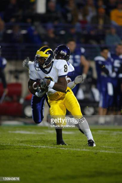 University of Michigan Wolverines' WR Jason Avant heads upfield after catching a Chad Henne pass during their game against the Northwestern...