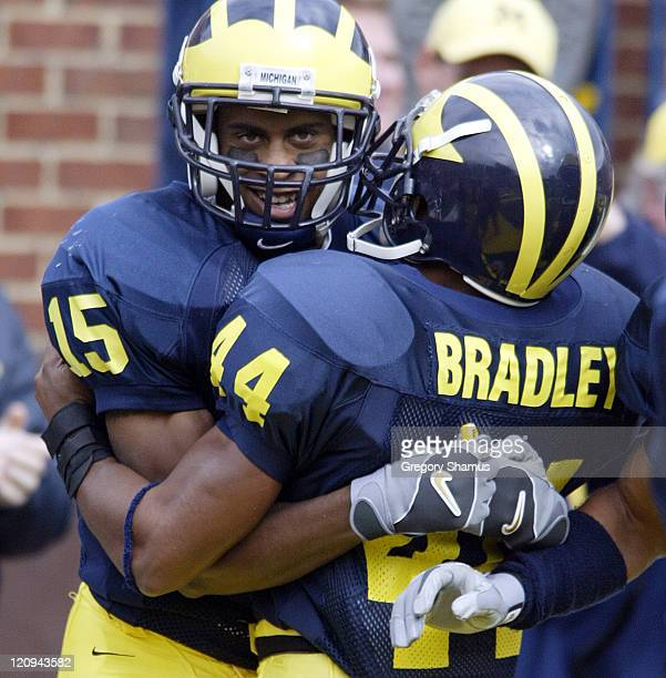 University of Michigan WR Steve Breaston celebrates his second quarter punt return for a TD against Illinois with teammate Alijah Bradley at Michigan...