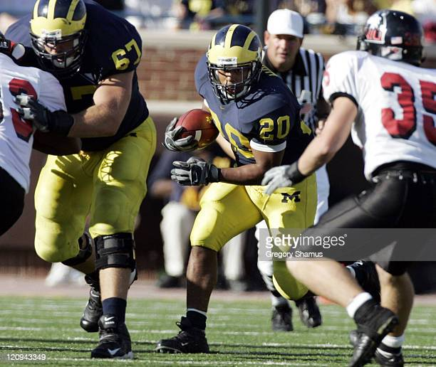University of Michigans Mike Hart looks for running room against Northern Illinois at Michigan Stadium on September 3 2005 Michigan won the game 3317