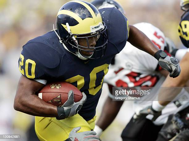 University of Michigans Mike Hart looks for running room during a game against Northern Illinois at Michigan Stadium on September 3 2005 Michigan won...