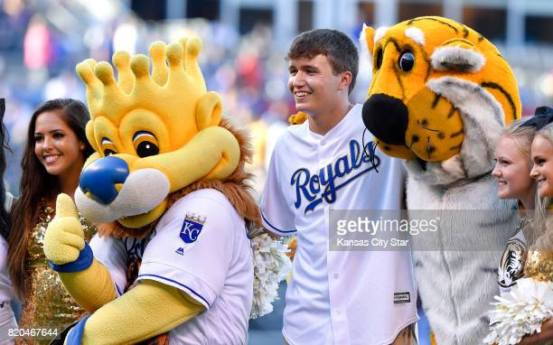 University of Missouri quarterback Drew Lock poses with Kansas City Royals mascot Slugger and Truman the Tiger after throwing out the ceremonial...