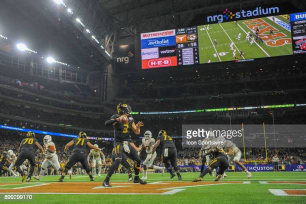University of Missouri Tigers quarterback Drew Lock looks to throw from his own endzone during the Texas Bowl game between the Texas Longhorns and...