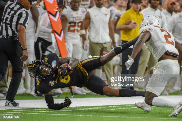 University of Missouri Tigers wide receiver J'Mon Moore is knocked out of bounds by University of Texas Longhorns defensive back Kris Boyd during the...