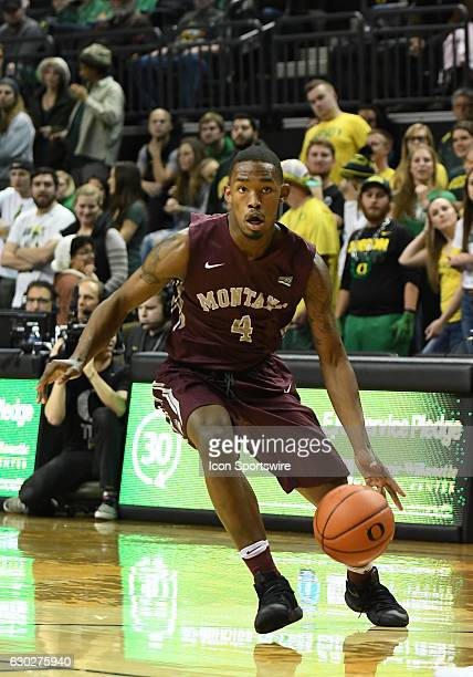 University of Montana freshman guard Sayeed Pridgett dribbles up court during a nonconference NCAA basketball game between the University of Montana...