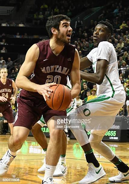 University of Montana junior forward Fabijan Krslovic looks to shoot past University of Oregon senior forward Chris Boucher during a nonconference...