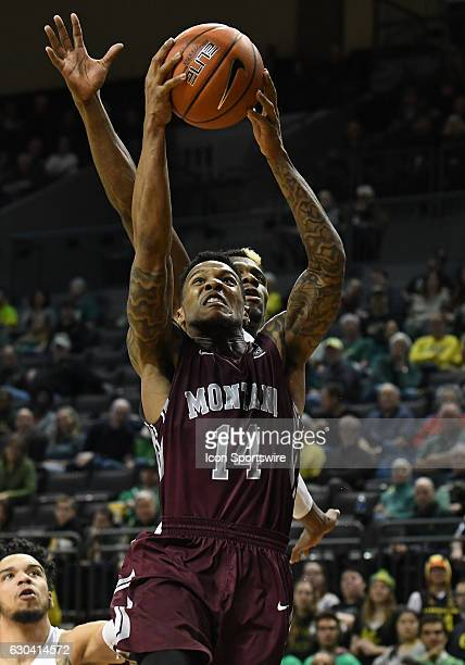 University of Montana redshirtsophomore guard Ahmaad Rorie goes in for a shot past University of Oregon guard Dylan Ennis during a nonconference NCAA...