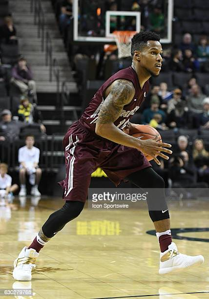 University of Montana redshirtsophomore guard Ahmaad Rorie readies to pass during a nonconference NCAA basketball game between the University of...