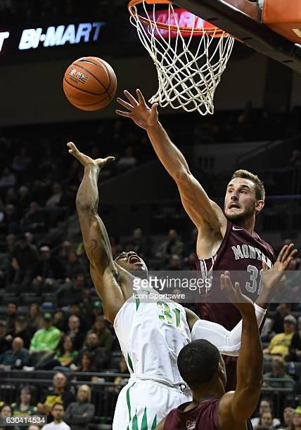 University of Montana senior forward Jack Lopez blocks the shot of University of Oregon guard Dylan Ennis during a nonconference NCAA basketball game...