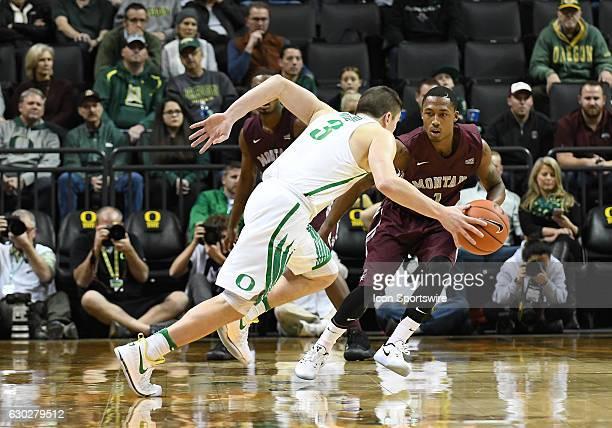 University of Montana senior guard Mario Dunn defends against University of Oregon freshman guard Payton Pritchard during a nonconference NCAA...
