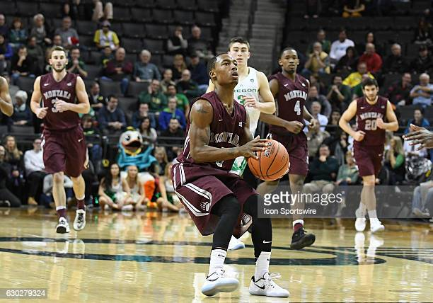 University of Montana senior guard Walter Wright readies to pull up for a jump shot during a nonconference NCAA basketball game between the...