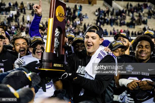 University of Mount Union head coach Vince Kehres raises the national championship trophy following the Division III Men's Football Championship held...