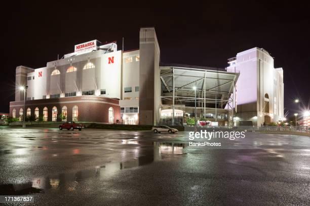 university of nebraska memorial stadium at night - lincoln nebraska stock pictures, royalty-free photos & images