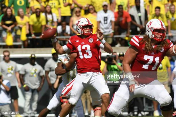 University of Nebraska QB Tanner Lee drops back to pass during a college football game between the Nebraska Cornhuskers and Oregon Ducks on September...