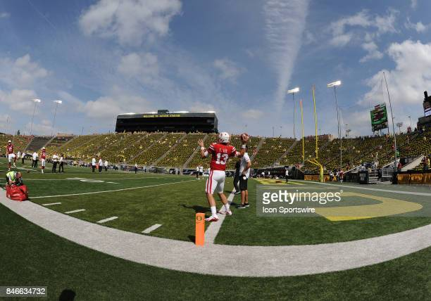 University of Nebraska QB Tanner Lee warms up prior to the start of the game during a college football game between the Nebraska Cornhuskers and...