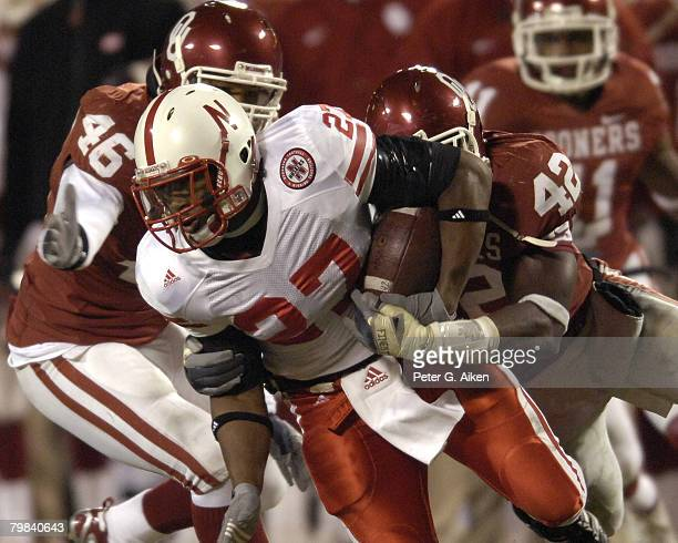 University of Nebraska running back Kenny Wilson is tackled from behind by Oklahoma linebacker Rufus Alexander in the second half during the Big 12...
