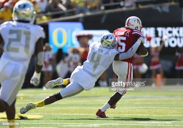 University of Nebraska WR De'Mornay PiersonEl runs the ball while defended by University of Oregon CB Thomas Graham Jr during a college football game...