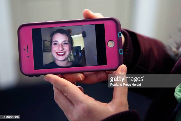 University of New England firstyear medical student Brianna O'Donnell holds a cellphone photo of her friend and classmate Deane Stryker who was...