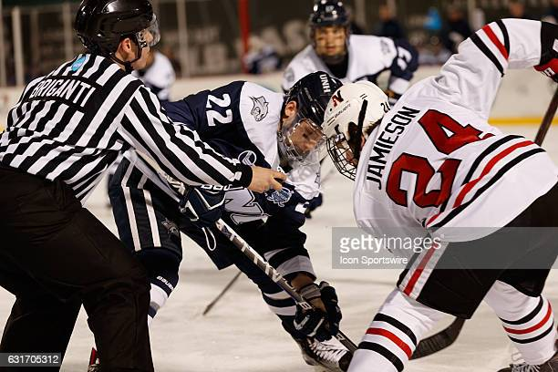 University of New Hampshire Wildcats forward Ara Nazarian faces off against Northeastern Huskies forward Mike Jamieson during the first period of the...