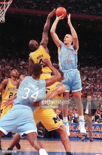 University of North Carolina center Eric Montross jumps up for the shot as University of Michigan forward Chris Webber tries to block during the NCAA...