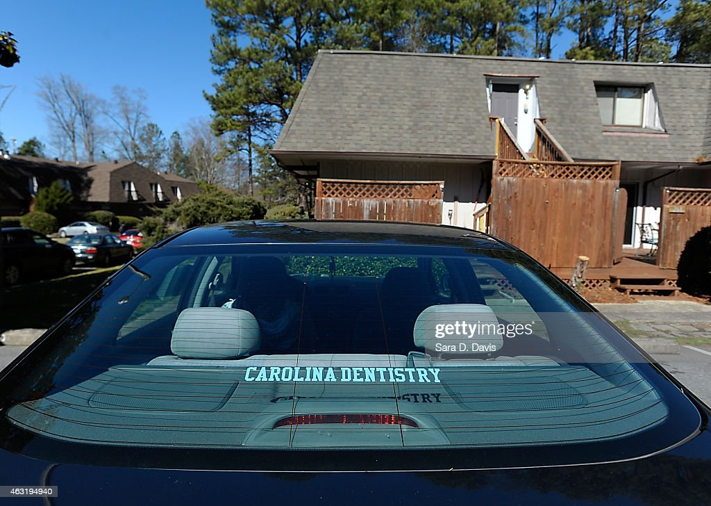 A University of North Carolina dentistry school sticker is seen on a Honda Accord outside the apartments of University of North Carolina dentistry student Deah Shaddy Barakat, 23, his new wife Yusor Mohammad, 21, and her sister Razan Mohammad Abu-Salha, 19, after their alledged murders at the Finley Forest condominium complex on February 11, 2015 in Chapel Hill, North Carolina. Craig Stephen Hicks, 46, was charged with three counts of first-degree murder in the shooting of death of three Muslim Americans over a parking dispute near the University of North Carolina at Chapel Hill campus.