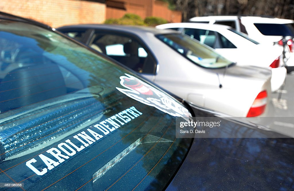 A University of North Carolina dentistry school sticker is seen on a Volkswagon Jetta outside the apartments of Craig Stephen Hicks, 46, University of North Carolina dentistry student Deah Shaddy Barakat, 23, his new wife Yusor Mohammad, 21, and her sister Razan Mohammad Abu-Salha, 19, at the Finley Forest condominium complex February 11, 2015 in Chapel Hill, North Carolina. Hicks has been charged with three counts of first degree murder with no bond for the alledged shooting Barakat, Mohammad and Abu-Salha. Chapel Hill police are investigating motives of a parking space dispute at the complex may have triggered the murders.