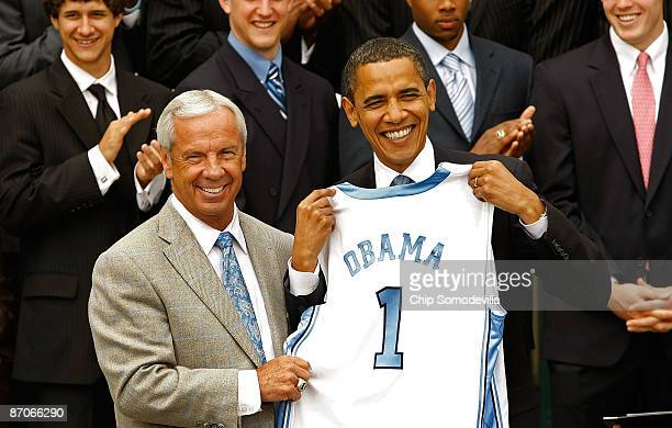 University of North Carolina Men's basketball head coach Roy Williams presents US President Barack Obama with a team jersey at the White House May 11...