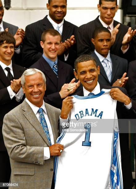 University of North Carolina men's basketball head coach Roy Williams present US President Barack Obama with a team jersey at the White House May 11...