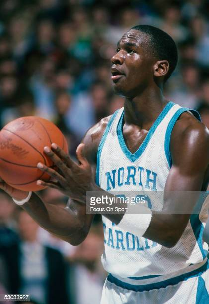 University of North Carolina's Michael Jordan eyes the basket before shooting from the foul line during a game.