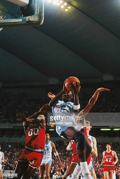 University of North Carolina's Michael Jordan jumps for an awkward layup during a game