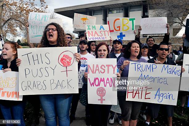University of Northern Colorado students demonstrate prior to Republican Presidential nominee Donald Trump's campaign rally at the Bank of Colorado...