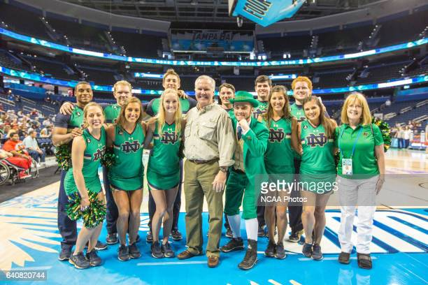 University of Notre Dame cheerleaders mascot and Tampa Mayor Bob Buckhorn pose together at an open practice session the Amalie Arena at the 2015...
