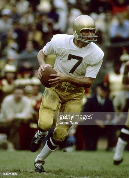 University of Notre Dame Fighting Irish quarterback Joe Theismann rolls out during Notre Dame's 21-21 tie with the University of Southern California...