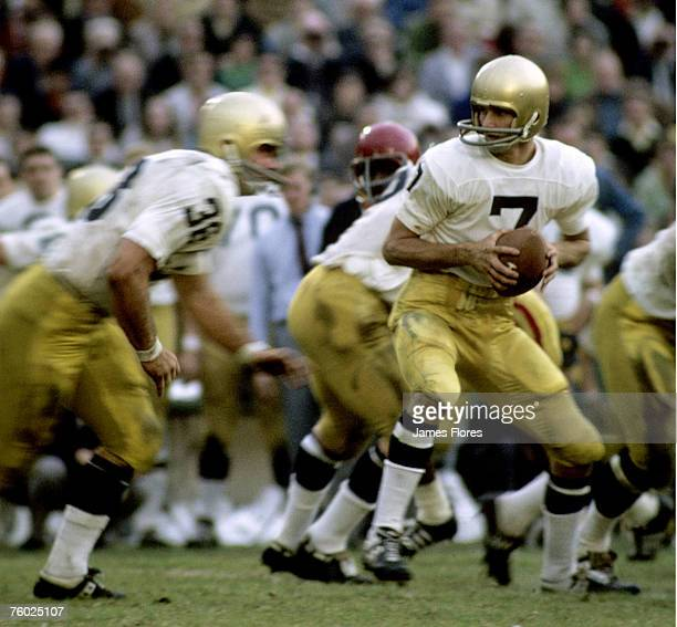 University of Notre Dame Fighting Irish quarterback Joe Theismann looks to handoff during Notre Dame's 21-21 tie with the University of Southern...